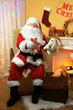 Santa Claus sitting with presents in comfortable chair near