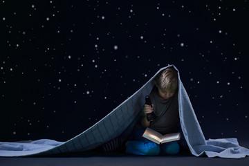 Reading under the blanket