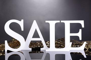 Sale on grey background