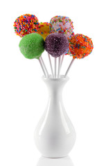Sweet cake pops in vase isolated on white