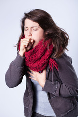 Coughing girl in scarf