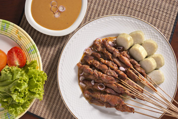 Chicken satay (trditional Indonesian food) shot from top down