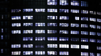 Office building and  people in the windows at work