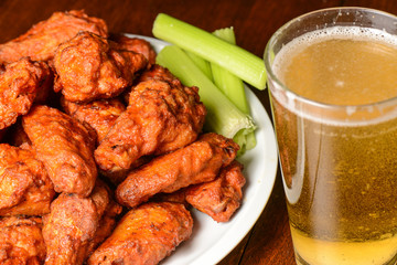 Buffalo Wings with Celery Sticks and Beer