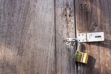 Gold brass lock on the wooden door