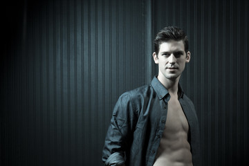 Confident Athletic Man In Unbuttoned Shirt