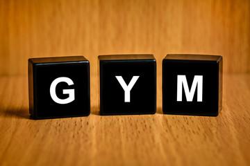 GYM or gymnasium or gymnastic services word on black block