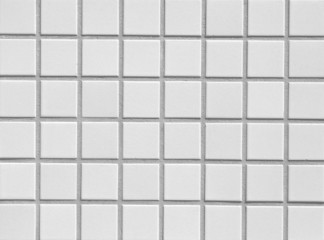 White mosaic tile wall seamless background and texture