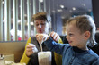 Boy eating foam of milkshake