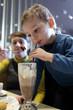 Kid drinks milk chocolate cocktail