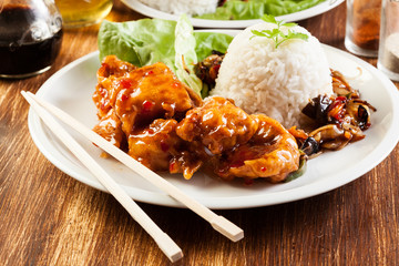 Fried chicken pieces with sweet and sour sauce