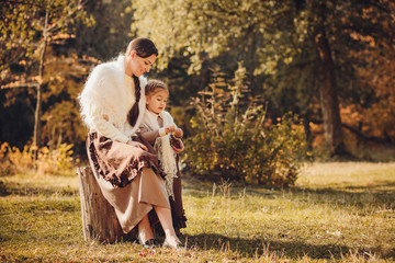 Mother and her daughter in vintage clothes
