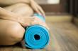Leinwandbild Motiv Young woman holding a yoga mat