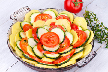 Tomatoes, potatoes and zucchini prepared for bake