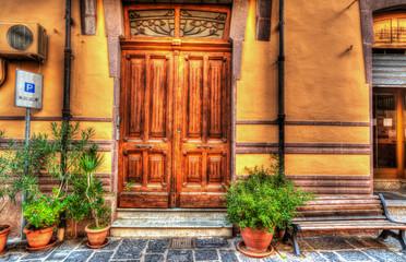 wooden door in Bosa, Italy