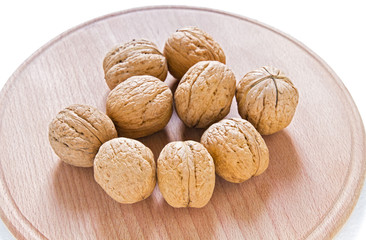 Walnuts on rustic  wooden table