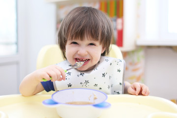 funny 2 years boy eating soup
