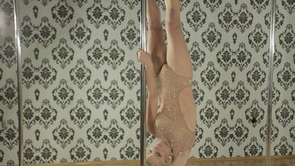 Girl in beige costume dance on pole