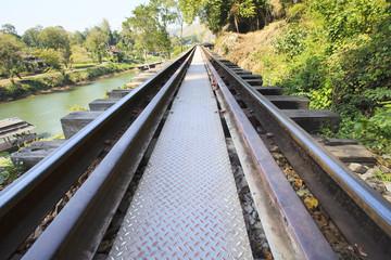 perspective of old wood bridge railways in kanchanaburi thailand