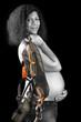 Schwangere Frau mit Kletterausrüstung