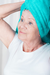 Woman with towel on head