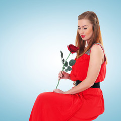 Romantic elegant woman in red dress with flower rose