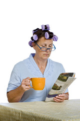 Woman Reading paper And Holding Coffee Cup Revised
