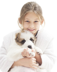 portrait of a smiling little girl and puppy shepherd