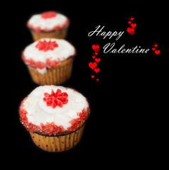 Happy Valentine cupcakes against dark background