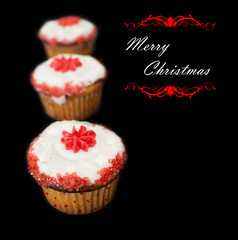 Merry Christmas cup cakes card against black background