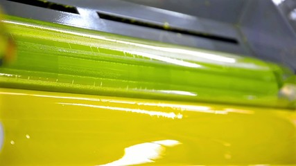 Yellow Paint Running Off a Roller in Offset Printing Press