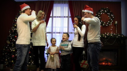 children with parents fireplace celebrate Christmas