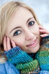 Winter beauty portrait of blonde woman with blue eyes.