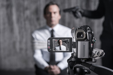 Filming hostage.