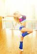 Young beautiful woman dancing in hall