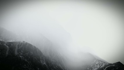 Flying over mountains in the fog