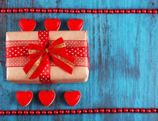 Cute gift for valentines day on wooden background