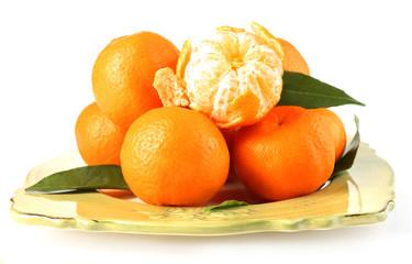 Tasty mandarins on plate isolated on white