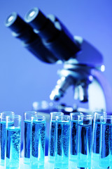 Test tubes on microscope background