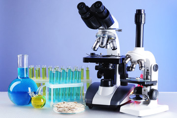 Microscopes, Petri dish with samples of grain and test tubes