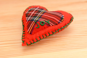Hand-stitched festive heart, embroidered with the word JOY