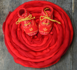 Red wool for felting and baby booties