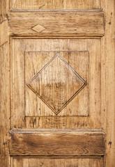 Old wooden decorative panel on the door