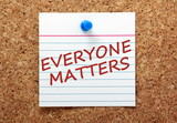The phrase Everyone Matters on a cork notice board