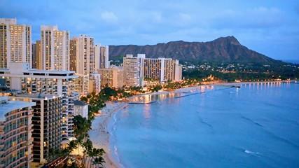 Night view on Honolulu city, Diamond Head and Waikiki Beach