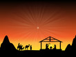 Baby Jesus in a Manger with a Glowing Star in the Sky - 75034409