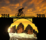 Cyclist riding across the bridge .Forward to the New Year 2015