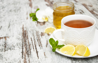 Cup of tea with lemon and honey