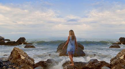 girl back on the beach