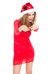 Girl in red dress and santa hat pointing finger at camera